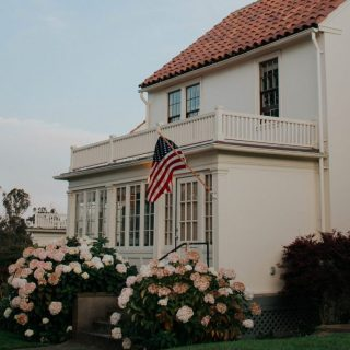 VA Home Loans photo of a Home with American Flag in front