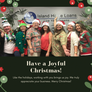 Island Home Loans Team photo for the holidays with everyone wearing festive sweaters and big smiles!